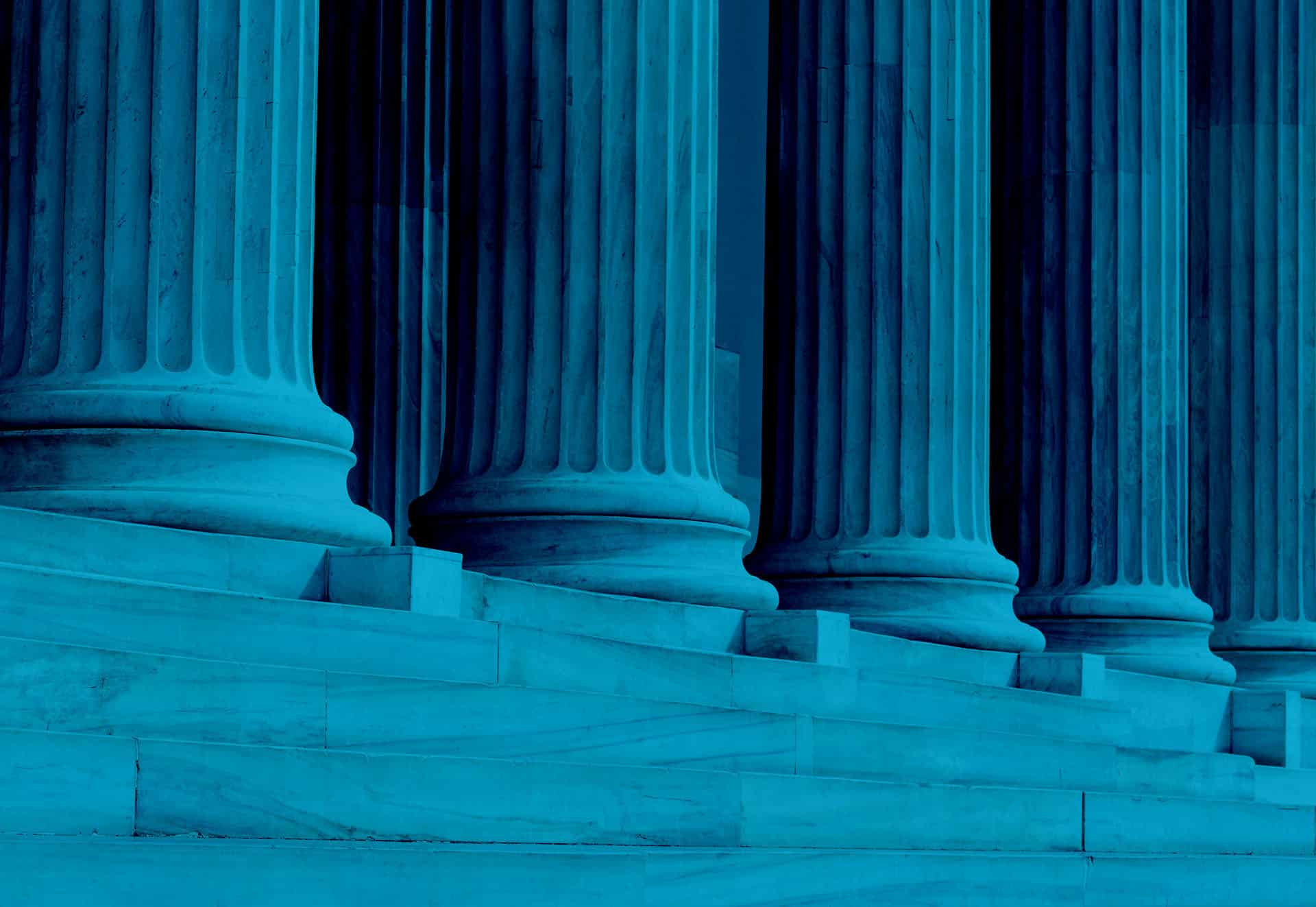 Blue-tinted image of pillars